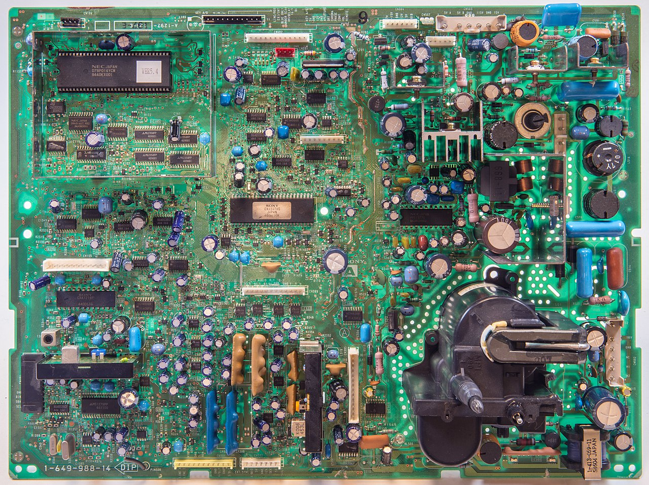 "A circuit board for a Sony Trinitron TV. <a href=""https://commons.wikimedia.org/wiki/File:Triniton-platine2a_hg.jpg"">Courtesy of Wikimedia Commons/Hannes Grobe</a>."