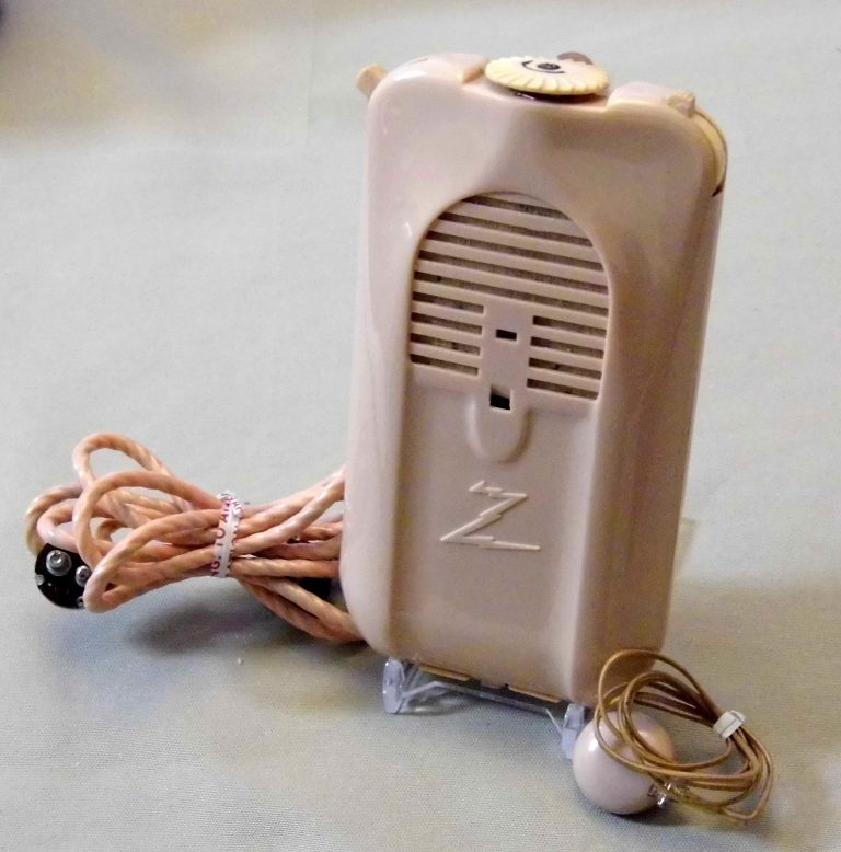 """A Zenith hearing aid circa 1944. It used vacuum tubes! Courtesy of <a href=""""https://commons.wikimedia.org/wiki/File:Vintage_Zenith_Radionic_3-Vacuum_Tube_(Body)_Hearing_Aid,_Model-A3A,_Pastel_Coralite_Case,_Bone-Air,_Original_Cost_%3D_50.00_USD,_Circa_1944_(10840966755).jpg"""">Wikimedia Commons/Joe Haupt.</a>"""